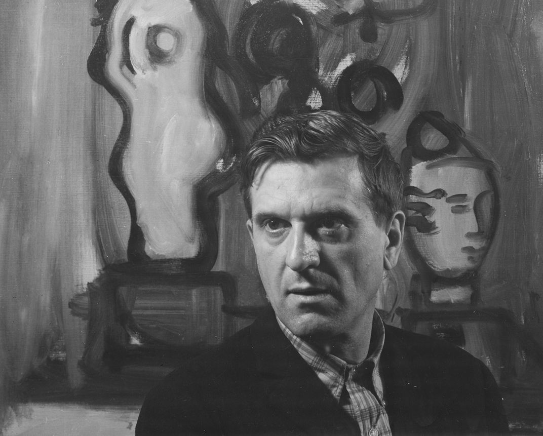 Robert De Niro, Sr. in front of <em>Flowers In A Blue Vase</em>, 1966, oil on canvas, 28 x 36 inches.