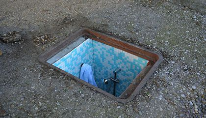 This Artist Builds Tiny Rooms in Milan's Forgotten Manholes