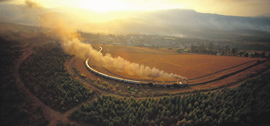 The <i>Rovos Rail</i> traveling through the savanna. Credit: Courtesy of &lt;i&gt;Rovos Rail&lt;/i&gt;