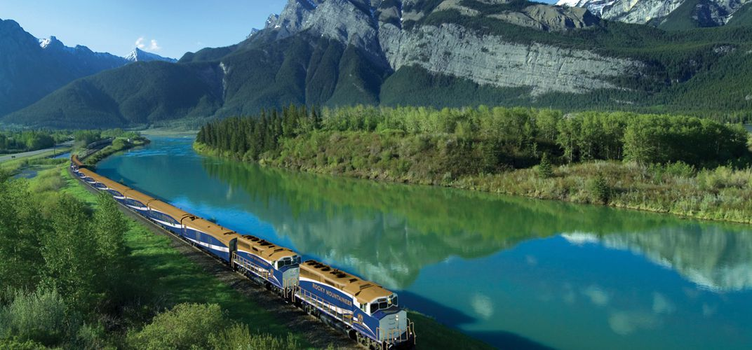 The <i>Rocky Mountaineer</i> traveling through the Canadian landscape