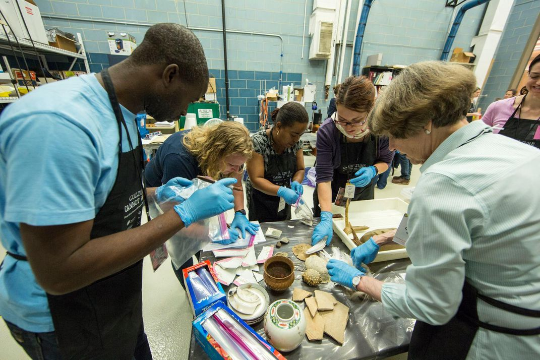 Smithsonian conservators and collections managers guided participants through several different tables of damaged objects and gave instructions on how best to handle each type. (Michael Barnes, Smithsonian)