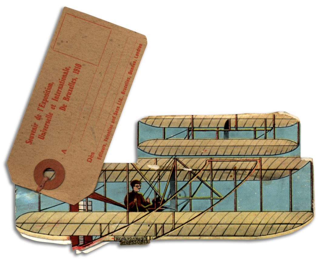 souvenir booklet whose cover looks like a Wright biplane
