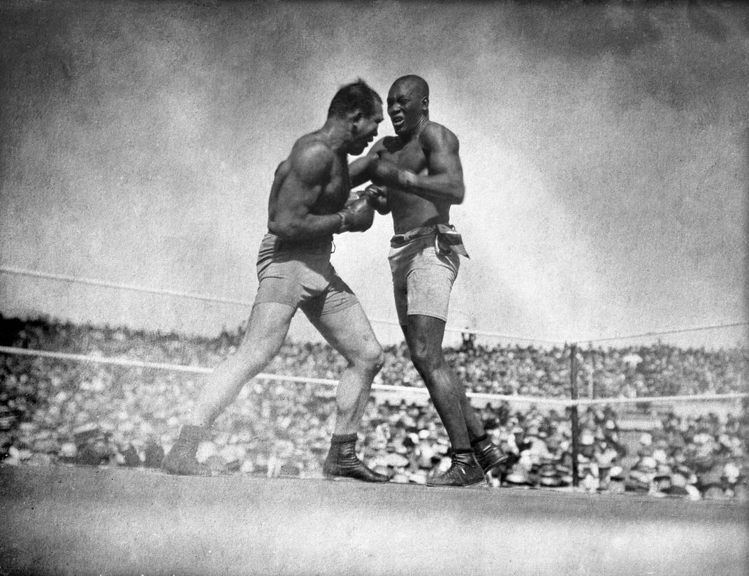 Jack Johnson (right) defeated Jim Jeffries in a 1910 boxing showdown