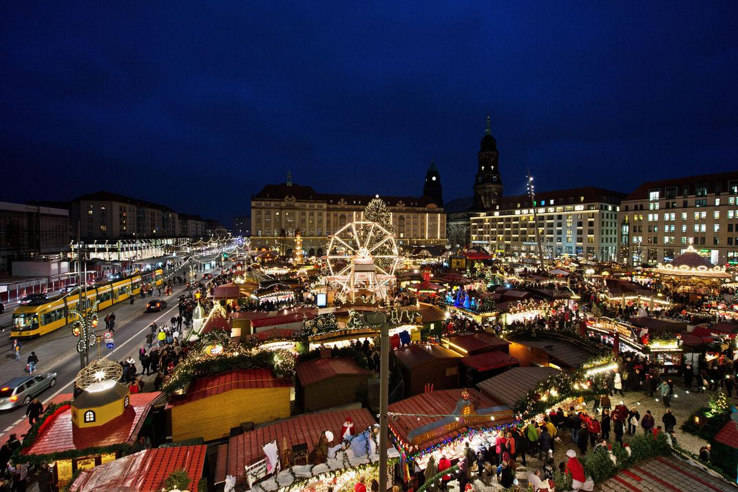 the striezel market takes place in dresden germany each year portions of a giant fruitcake baked at the dresden stollen festival in early december are