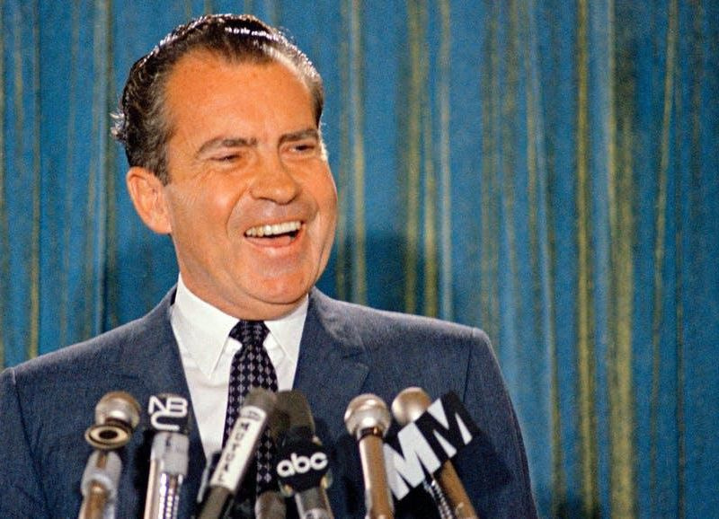 Republican presidential candidate Richard Nixon smiles for the cameras during a 1968 news conference.