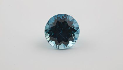 turquoise round gem on its side