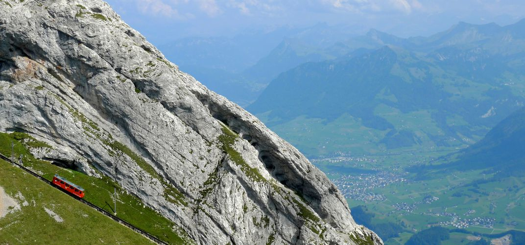 View of Mt. Pilatus and the <i>Pilatus Railway</i>, the world's steepest cogwheel railway (lower left)