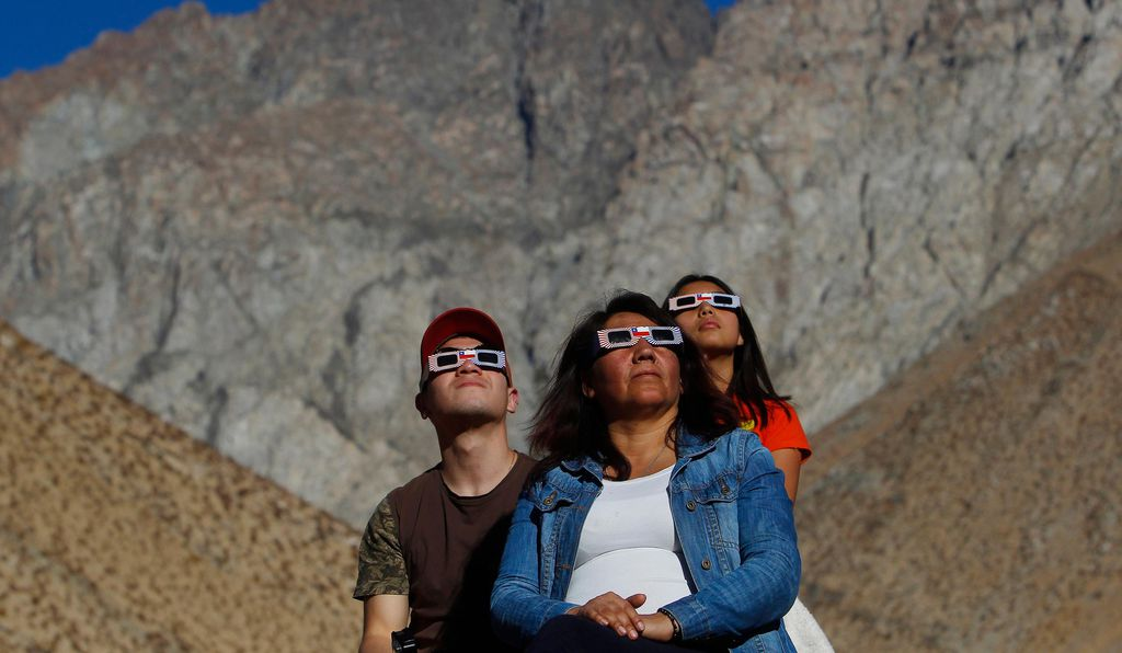 A family in Paiguano, Chile watches the eclipse.