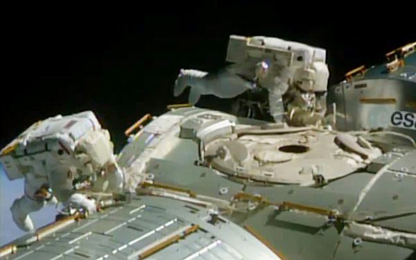 Spacewalking astronauts turn cable guys