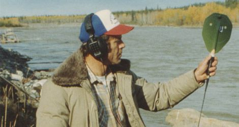 A biologist with a salmon tracking device