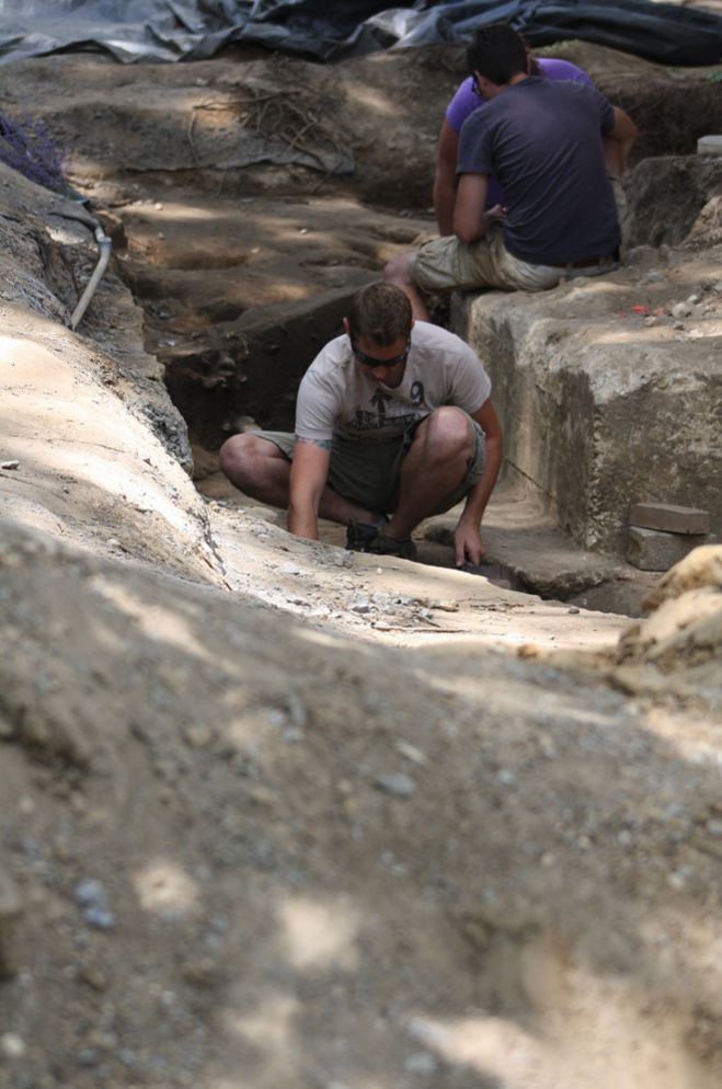 A student conducting archaeological research on the campus of St. Mary's College of Maryland