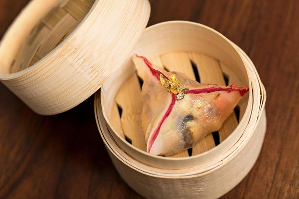 A (professionally done) imperial fungus dumpling, topped with gold leaf.