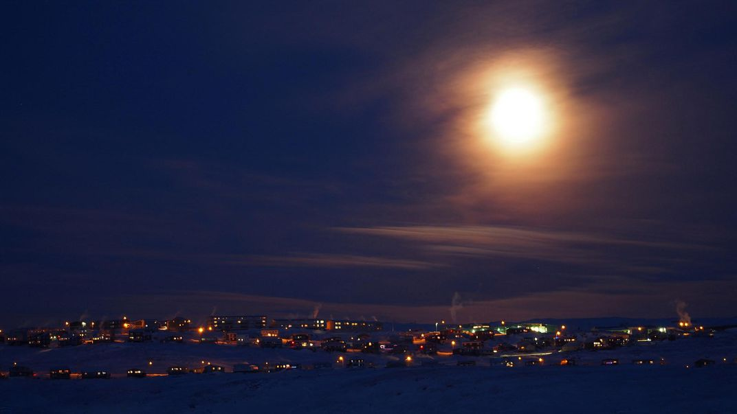 Taken around 3:30 PM local time the wolf moon looms large in the skies of Iqaluit the capital city of Nunavut Canada