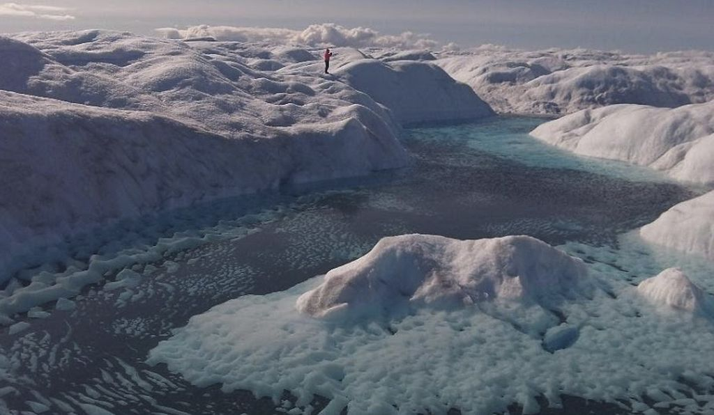 When enough dust accumulates on an ice sheet, the cryoconite holes merge and turn into lakes, such as this one in Greenland.