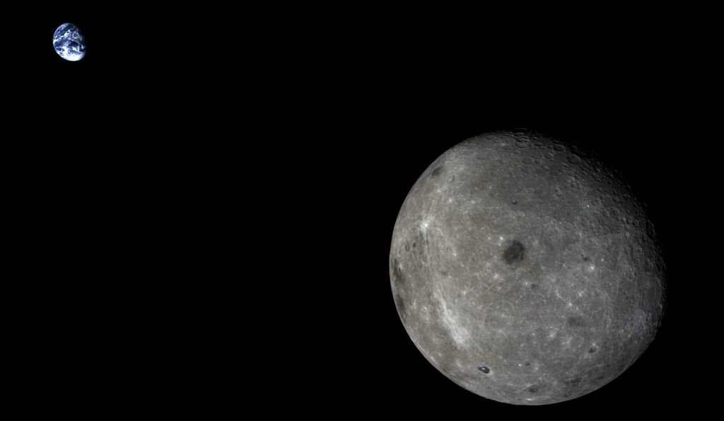 China's Chang'e 5-T1 spacecraft took this image of the Earth and Moon in 2014.