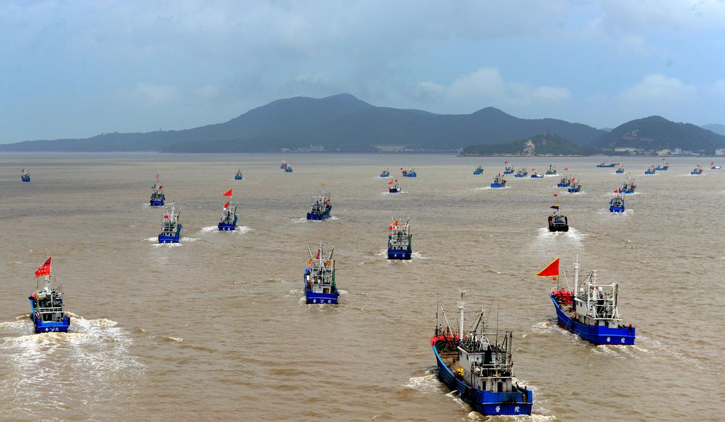 Fishing boats set sail to East China Sea for fishing on August 1, 2017 in Zhoushan, Zhejiang Province of China. Over 3,500 fishing boats set off from Shenjiamen fishing harbor.