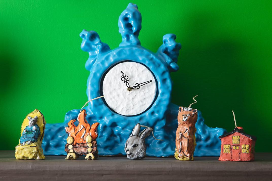 Detail of ceramic mantlepiece clock by Keith Simpson and <em>Goodnight Moon</em>​ character-inspired candles by Janie Korn
