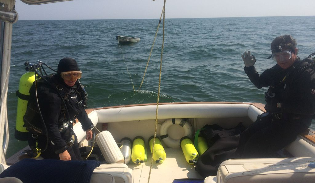 Archaeologist Carrie Sowden, left, prepares to dive into Lake Erie with Chris Kraska, right, an underwater archaeologist with the Maritime Archaeological Survey Team.