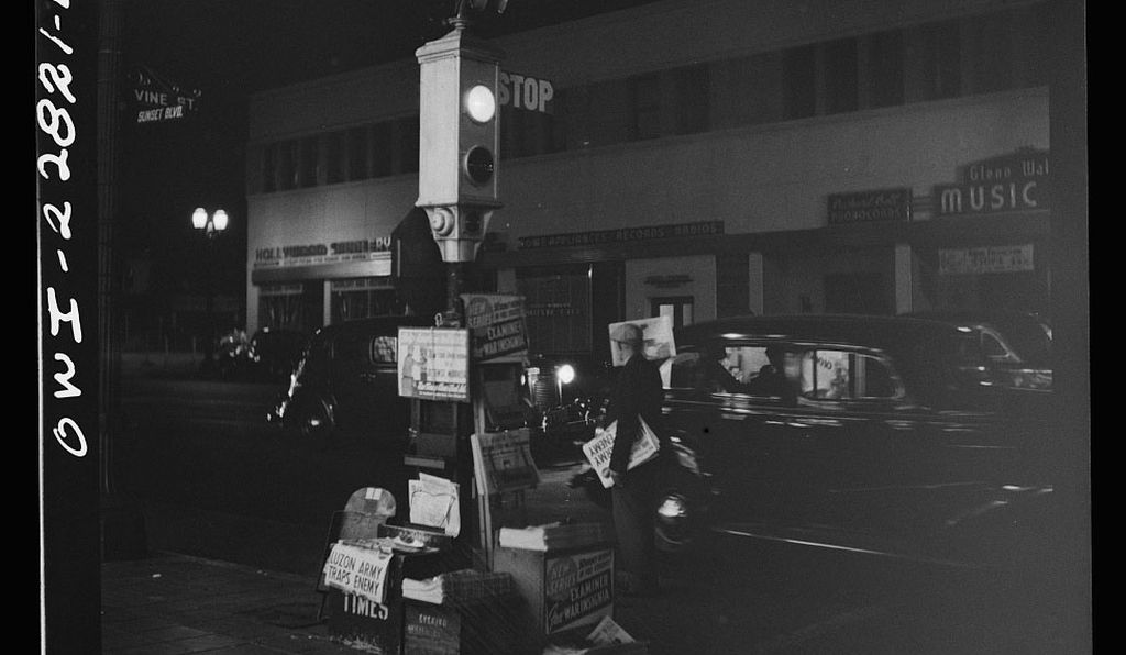 A newsboy's stand and traffic light in Los Angeles, 1942