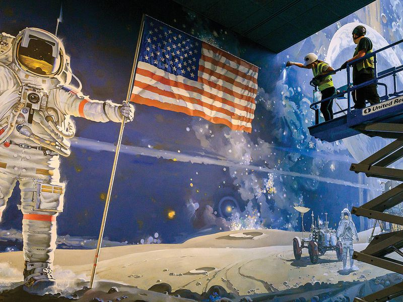 contractor inspecting A Cosmic View moon mural