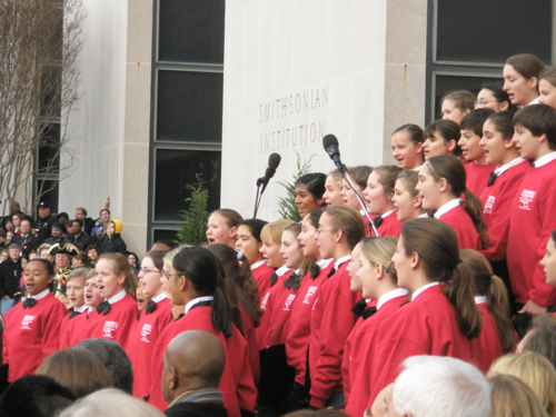 The children's chorus performing outside the museum