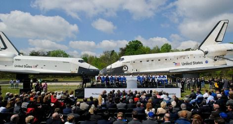 Discovery, right, greets the departing Enterprise, left, at the Welcome Discovery ceremony.