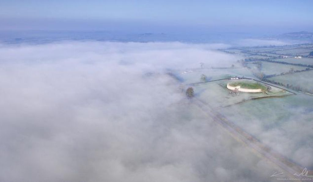 An aerial view of Newgrange on a misty morning