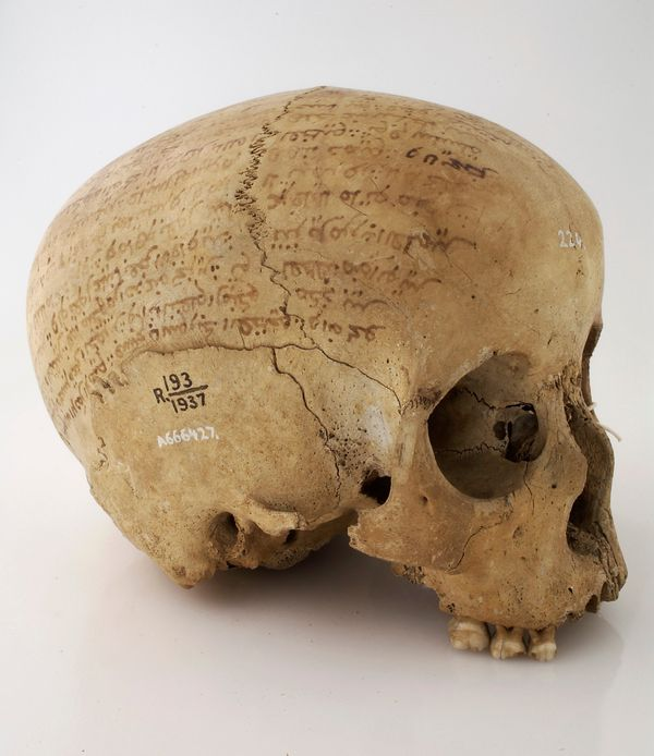 A skull inscribed with a prayer