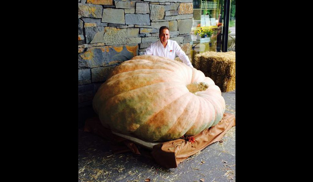 Ron Wallace poses with his record-setting 2,230 pound monster. He now holds the record for heaviest pumpkin in North America.