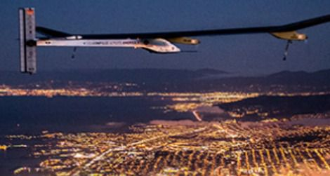The Solar Impulse flying over San Francisco at night.