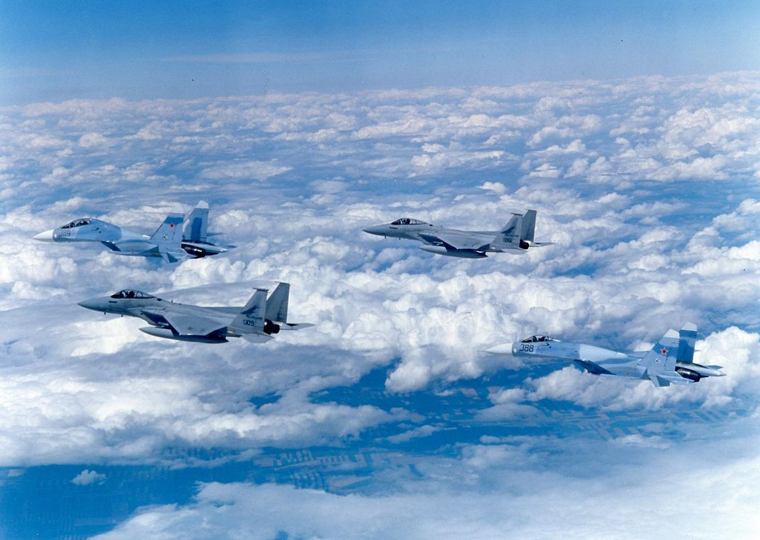 Su-27 escorted by F-15s in clouds