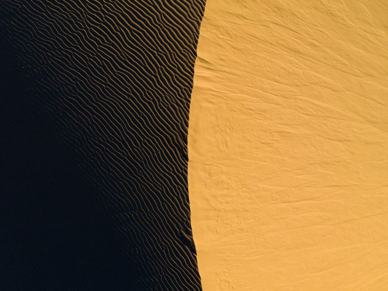 An abstract aerial view of a sand dune at sunset at Imperial Sand Dunes, Glamis, California.