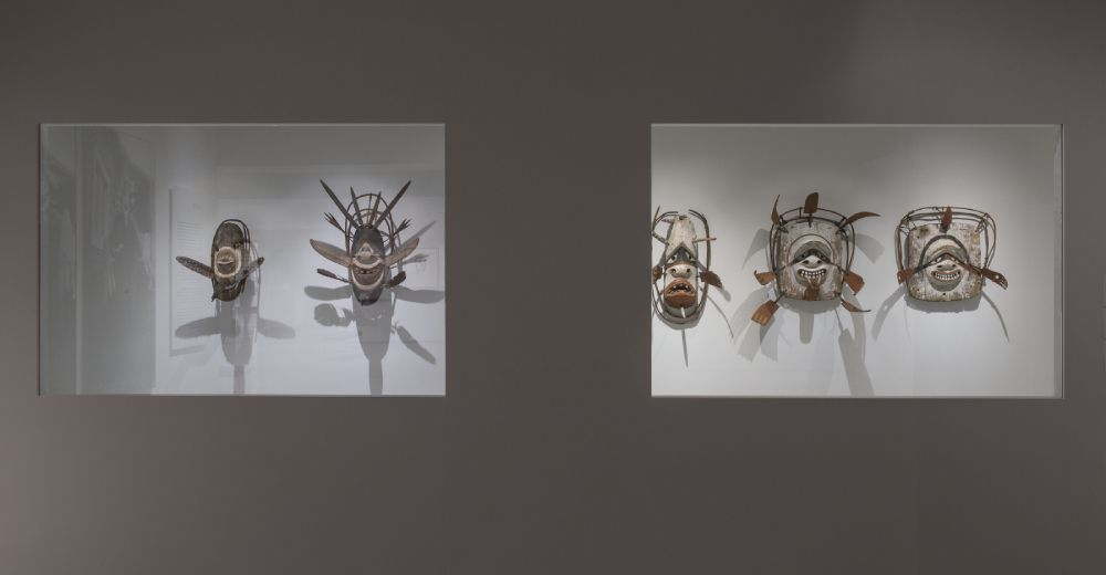 Heard Museum exhibition gallery featuring five Alaska Native masks.