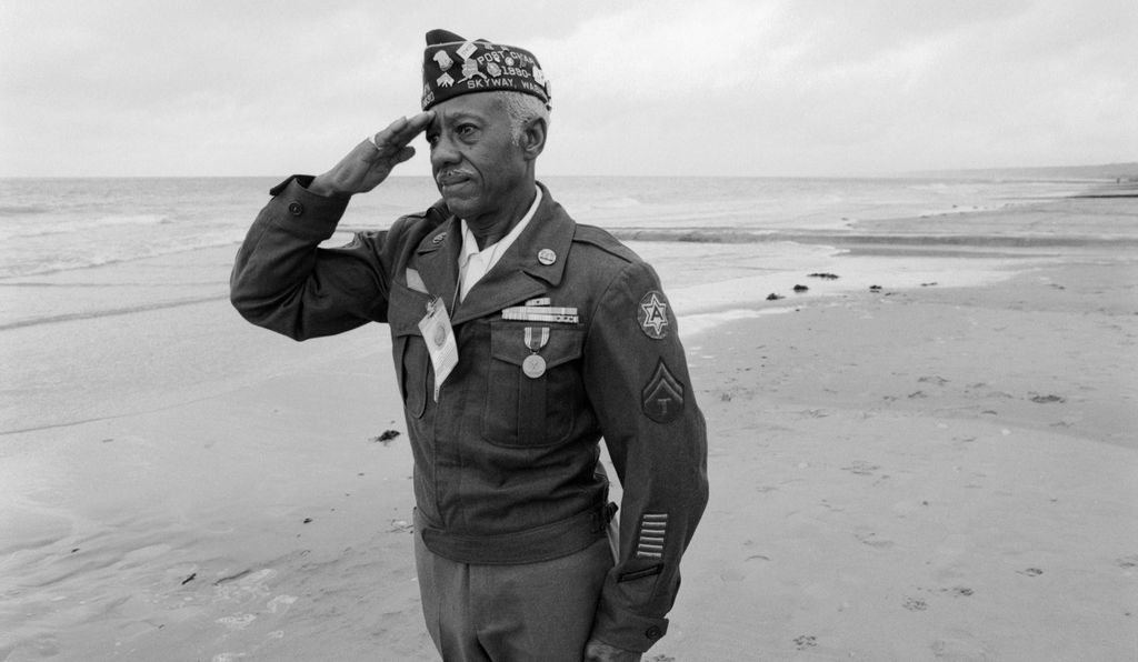 A D-Day veteran salutes his lost comrades on the 25th anniversary of the battle, 1994.
