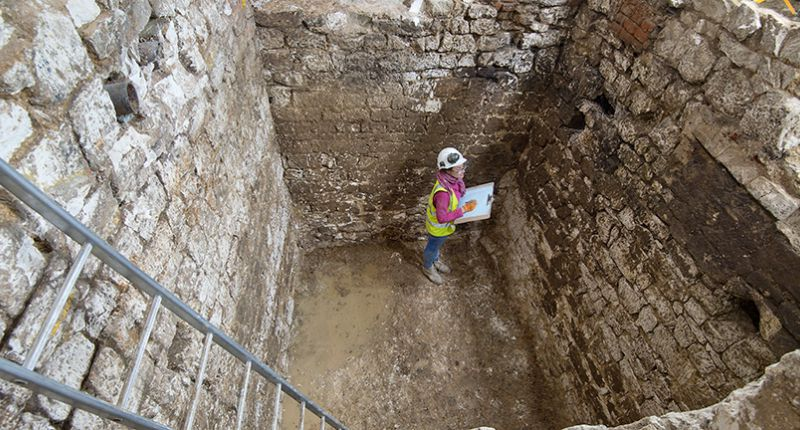 Archaeologists in cesspit