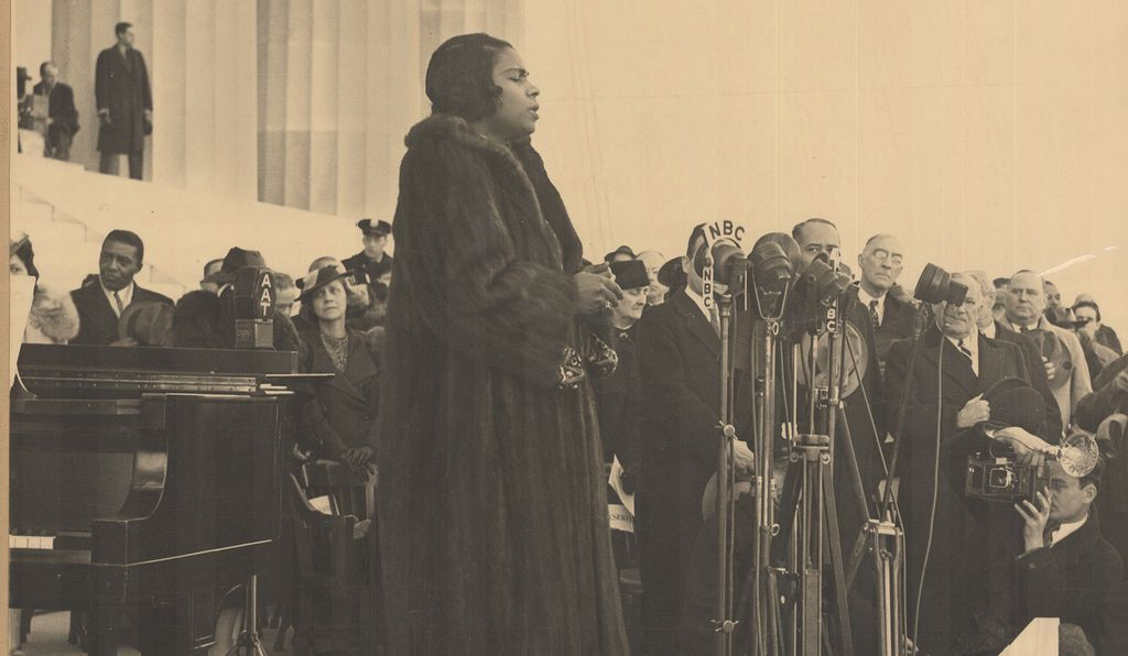 Standing before many microphones, Marian Anderson (above: by Robert S. Scurlock, 1939, detail) sang from the steps of the Lincoln Memorial before a crowd of 75,000.