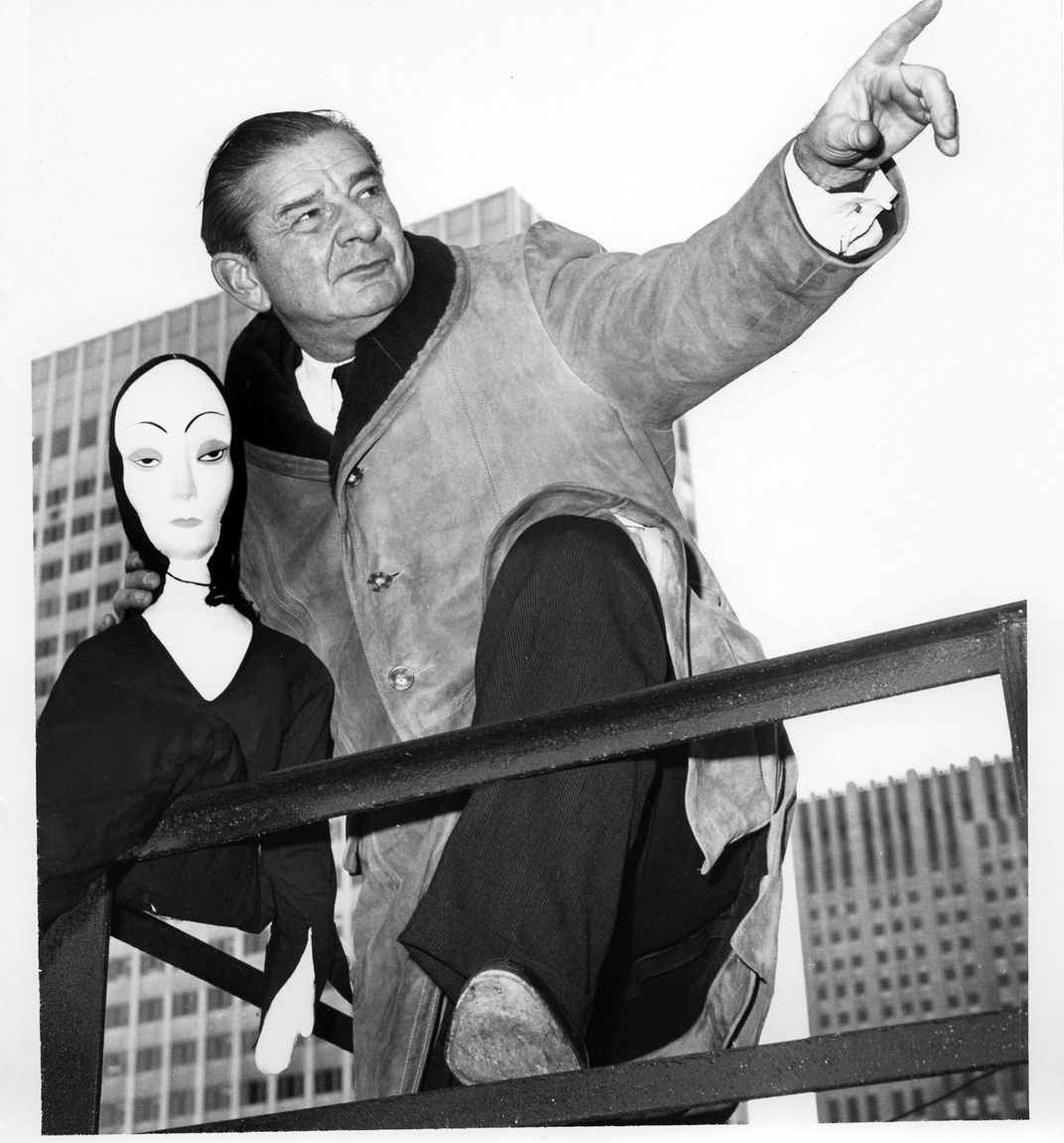 Charles Addams with a Morticia doll.
