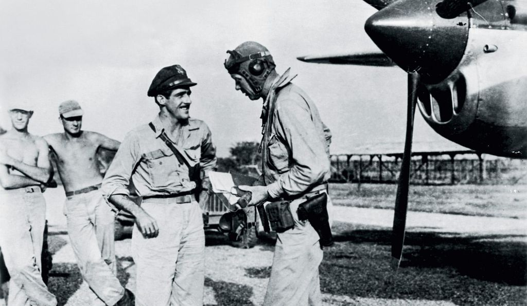 The Fifth Air Force's second highest-scoring ace, McGuire, left, confers with Charles Lindbergh. The famous pilot's stint with the 475th was one of the few times a civilian non-combatant was allowed by the U.S. Army Air Forces to hunt and kill the enemy.
