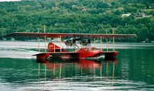 A reproduction of the 1914 Curtiss flying boat America takes to the water.