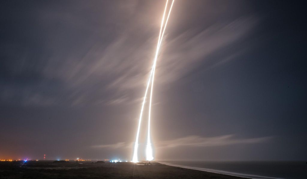 Twin streaks: a time exposure catches both the launch of the Falcon 9 on December 21, 2015, and the return of its first stage to Cape Canaveral.