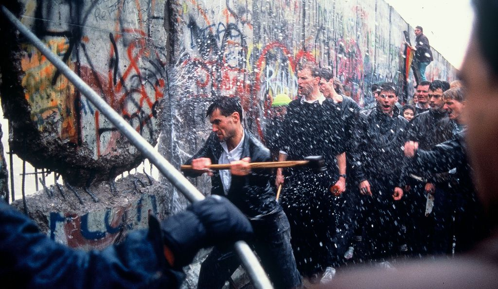 Men hammering through the Wall as E. German guards fire water cannon through the crack, soaking everyone in that freezing morning. I found them before the official dismantling of the Wall.