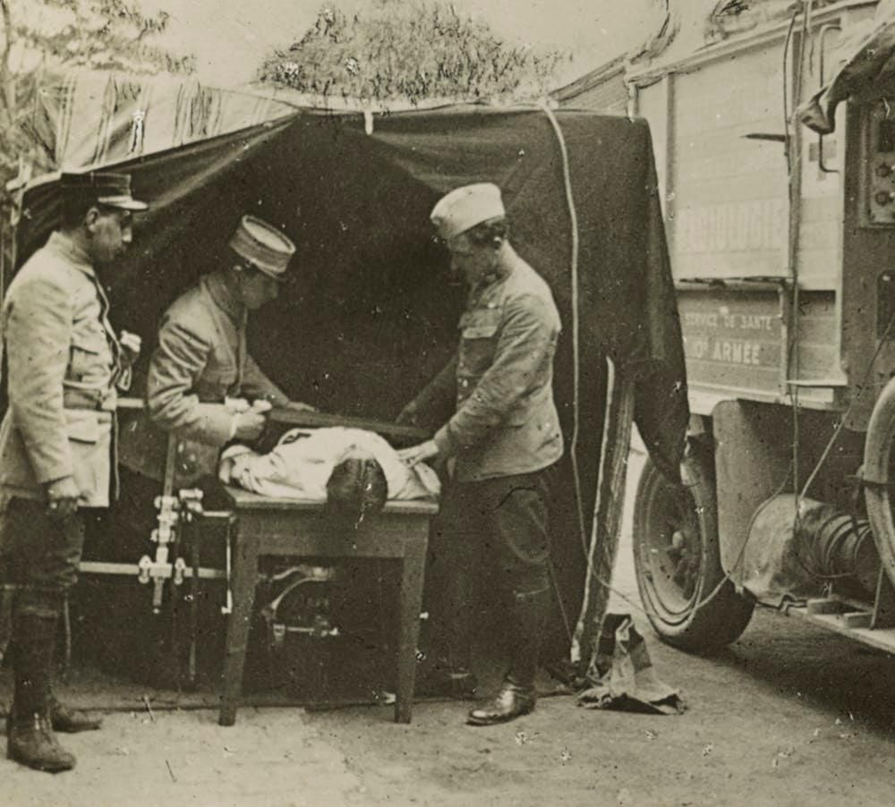 Medics at a French WWI field hospital locating a bullet with X-ray machine