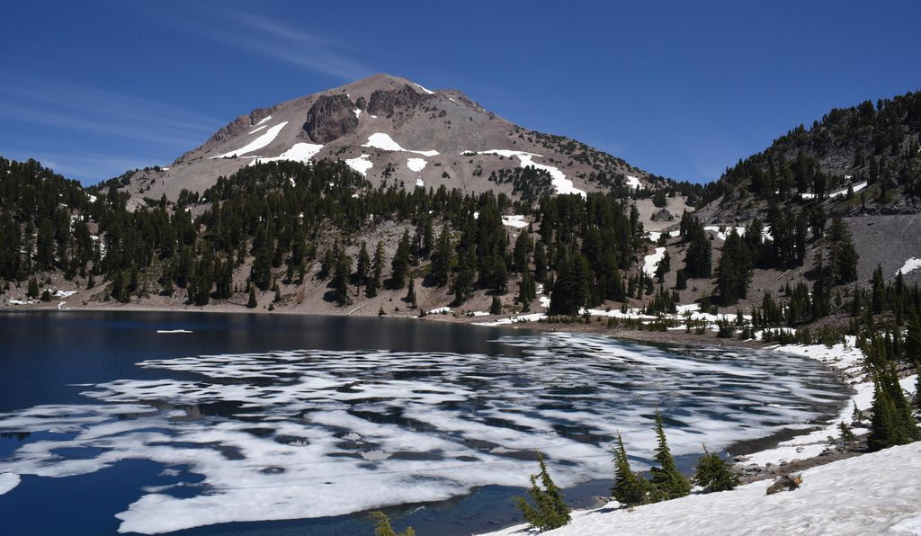 Lake Helen, still frosted with ice in July. The park is slated to grow hotter as climate change takes its toll.