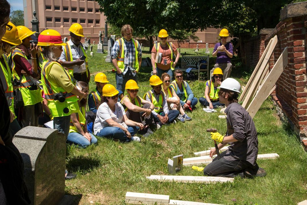 Participants learning shoring techniques from Tim Bowden, Robert Silman Associates, at Congressional Cemetery. (Michael Barnes, Smithsonian)