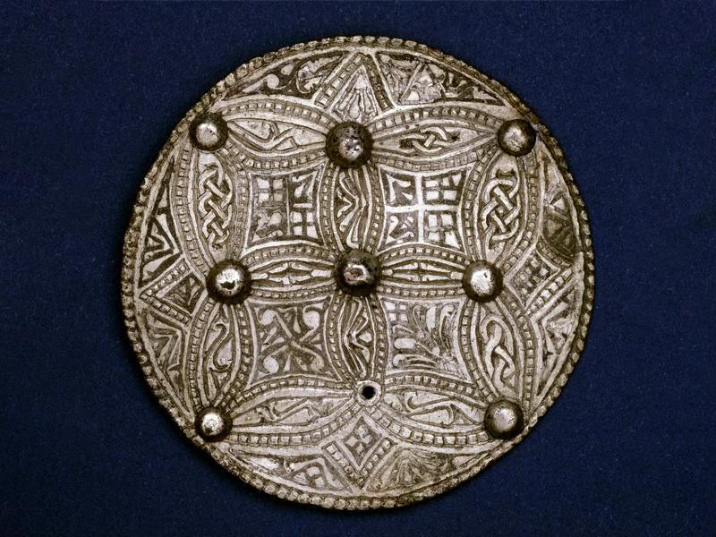Trewhiddle style silver sheet disc brooch from the Beeston Tor Hoard, discovered in 1924 by George Wilson at Beeston Tor in Staffordshire, England