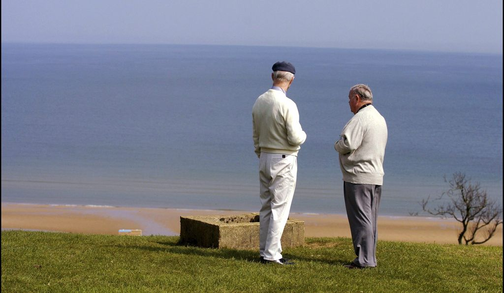 U.S. veteran Ronald MacArthur Hirst and German veteran Franz Gockel relive the invasion from a cliff overlooking the beach, 2004.