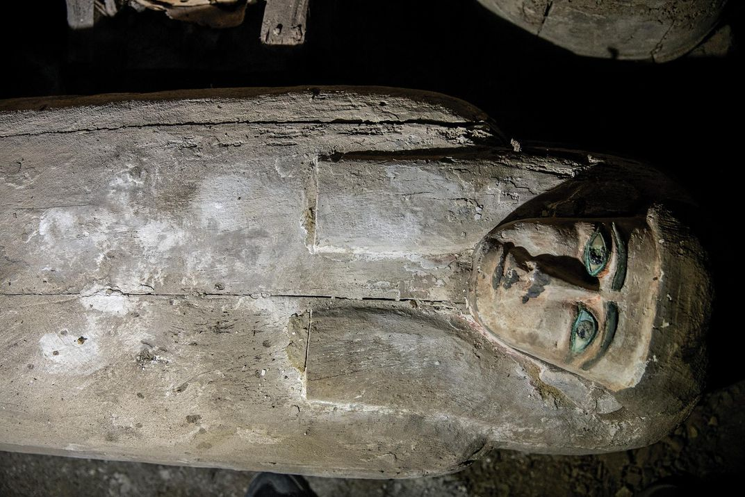 The tilted            mask on coffin