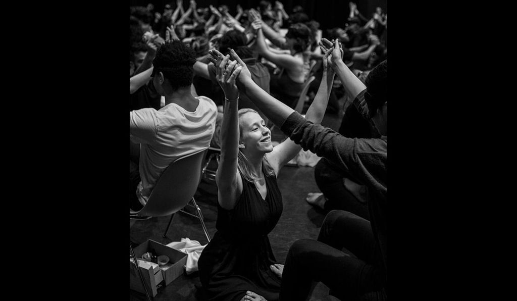 A dancer in black imparts the sense of touch during a dress rehearsal for the Brooklyn show.