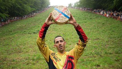 Holey Swiss: Man Breaks Record in British Downhill Cheese Race