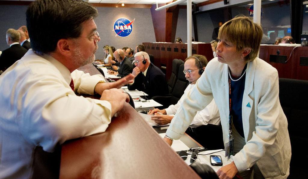 Zuber, right, talks with Jim Adams, then-NASA Deputy Director of Planetary Division, left, before a launch attempt for the GRAIL mission.
